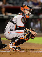 Sep. 14, 2012; Phoenix, AZ, USA; San Francisco Giants catcher Buster Posey (28) looks for the sign from coaches during the game against the Arizona Diamondbacks at Chase Field.  The Giants defeated the Diamondbacks 6-2. Mandatory Credit: Jennifer Stewart-US PRESSWIRE