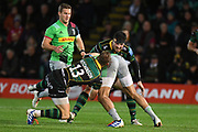 Northampton Saints centre Rory Hutchinson (13) makes a tackle during the Gallagher Premiership Rugby match between Northampton Saints and Harlequins at Franklins Gardens, Northampton, United Kingdom on 1 November 2019.