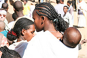 Africa, Ethiopia, Lalibela, woman with Plaited hair and baby on back