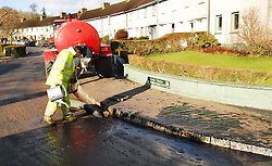 Westport Council worker dealing with the Oil Leak at St Mary's Crescent, Westport...Pic Conor McKeown