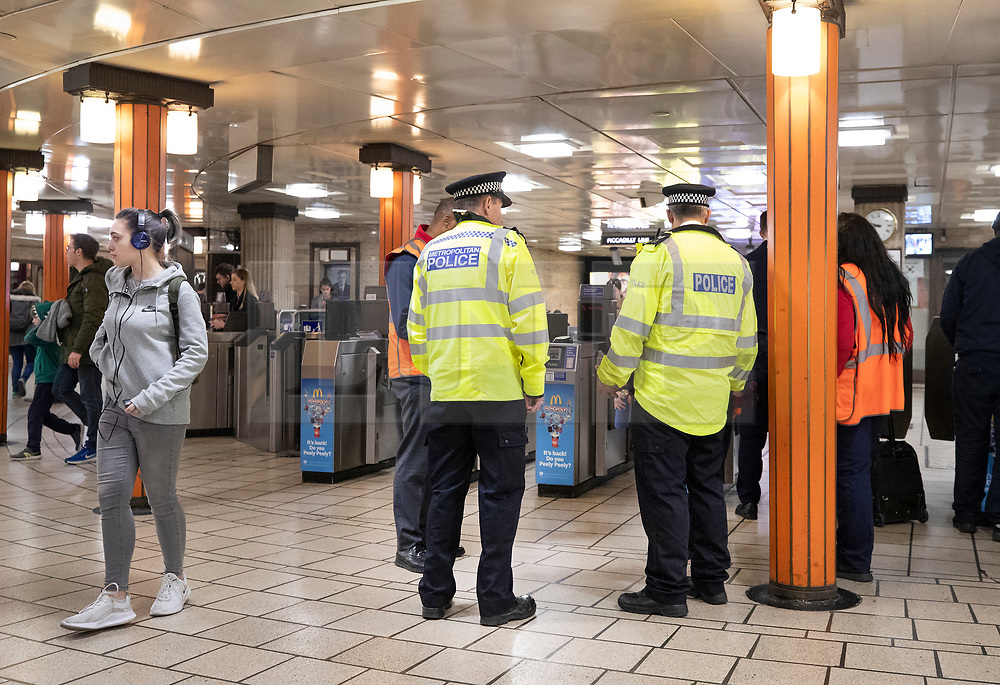 © Licensed to London News Pictures. 17/04/2019. London, UK. Police guard the ticket hall at Piccadilly underground station after XR (Extinction Rebellion) climate change protest group threatened to continue their demonstrations and blockades on the tube network. XR actions are still blocking traffic at various location across the capital despite nearly 300 arrests and are expected to disrupt underground travel today. Photo credit: Peter Macdiarmid/LNP