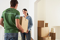 Couple Moving into New Home carrying box