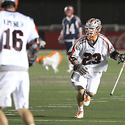Drew Snider #23 of the Denver Outlaws runs with the ball during the game at Harvard Stadium on May 10, 2014 in Boston, Massachusetts. (Photo by Elan Kawesch)