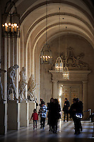 Various statues line the corridors of the Palace of Versailles, Paris, France