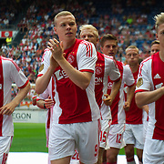 Amsterdam, 25-07-2013. Zo'n 20.000 fans waren naar de Amsterdam Arena gekomen voor de Open dag van Ajax. De spelers werden gepresenteerd  en trainden in de Arena. Foto: Davy Klaassen, Kolbeinn Sigthorsson en Viktor Fischer.