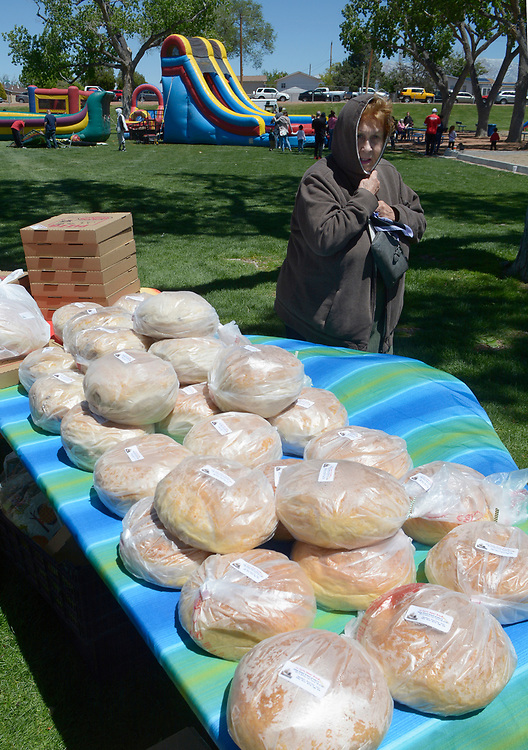 gbs043017m/RIO-WEST -- Dee Barela of Albuquerque bought some bread at the La Cajita booth during the Day in Paradise celebration in Paradise Park on Sunday, April 30, 2017. (Greg Sorber/Albuquerque Journal)