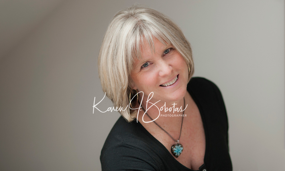 Natural light studio setting portraits of a 52 year old woman