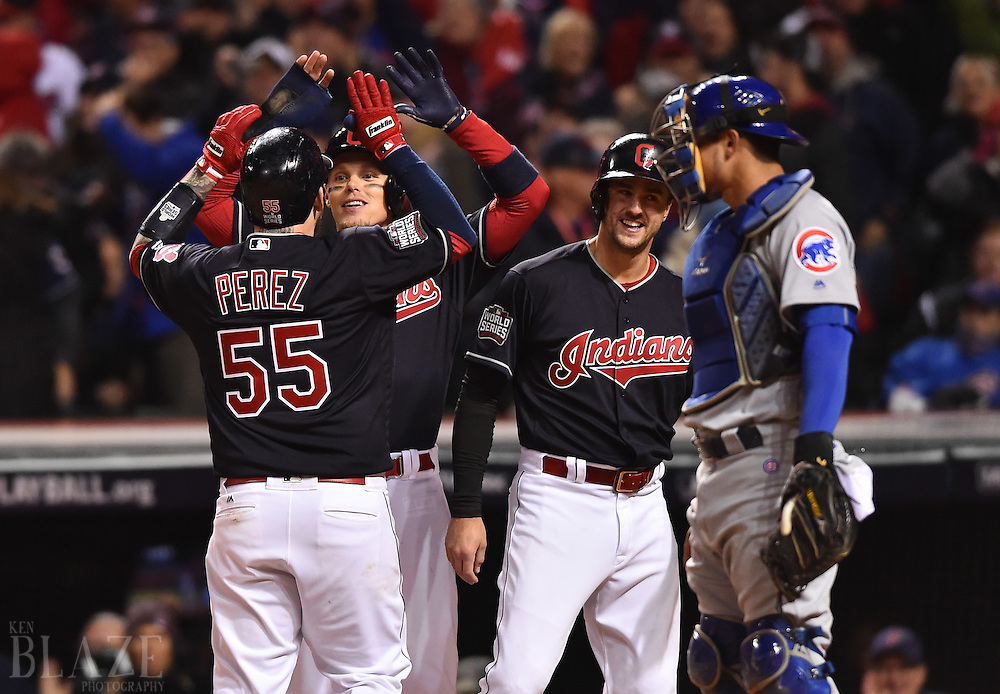 Oct 25, 2016; Cleveland, OH, USA; Cleveland Indians catcher Roberto Perez (55) celebrates with teammates Brandon Guyer (middle) and Lonnie Chisenhall (right) after hitting a three-run home run against the Chicago Cubs in the 8th inning in game one of the 2016 World Series at Progressive Field. Mandatory Credit: Ken Blaze-USA TODAY Sports