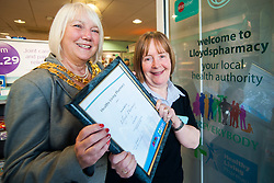 Lloyds Pharmacy Stocksbridge has achieved the status of 'Healthy Living Pharmacy'. A special accreditation for offering high levels of health screening  and advice to the local community. Pharmacy Manager Jackie Walter receiving the award from Mayor of Stocksbridge Susie Abrahams, ..04 October 2012.Image © Paul David Drabble