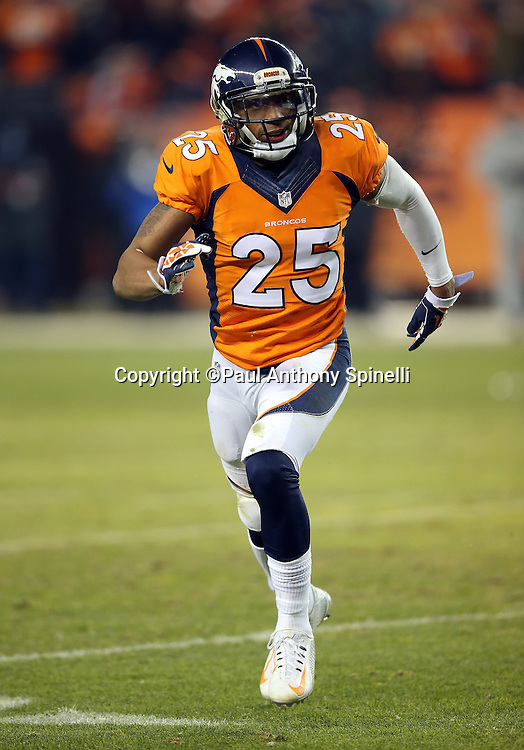 Denver Broncos cornerback Chris Harris Jr. (25) chases the action during the 2015 NFL week 16 regular season football game against the Cincinnati Bengals on Monday, Dec. 28, 2015 in Denver. The Broncos won the game in overtime 20-17. (©Paul Anthony Spinelli)