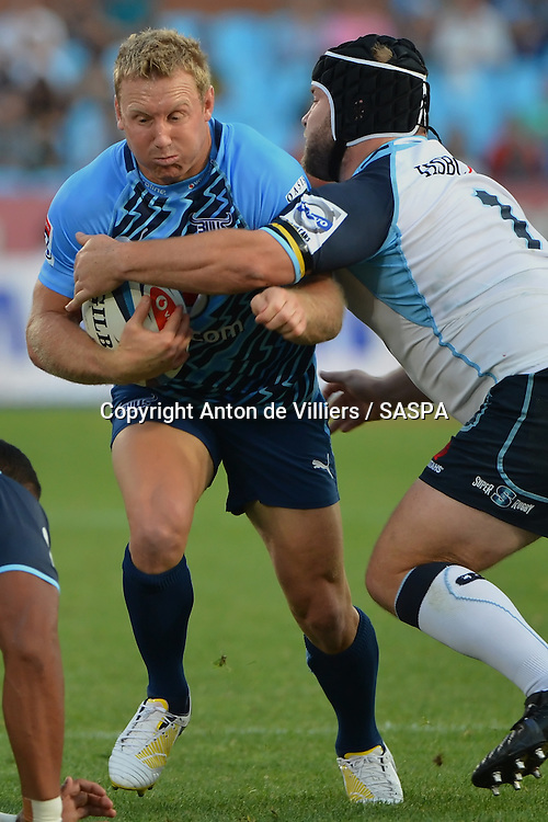 PRETORIA, South Africa, 27 APRIL 2013 : Jano Vermaak of the Bulls powering forward with Benn Robinson of the Waratahs making the tackle during the Super Rugby match between the BULLS and the WARATAHS at Loftus Versfeld in Pretoria, South Africa on 27 APRIL 2013. Bulls 30 - 19 Waratahs.<br /> <br /> &copy; Anton de Villiers / SASPA