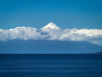 The Osorno Volcano towers above the landscape of all the nearby towns near Puerto Vara, not too far from the Puerto Montt, where our cruise ship, the Crown Princess anchored.<br /> <br /> This active volcano covered the landscape with ash two years ago.<br /> <br /> Puerto Varas, known as the city of roses, is located near the Vicente Perez Rosales National Park.<br /> <br /> This park contains the Petrohue River and Falls, as well as the beautiful Lake Esmeralda.