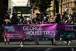 © Licensed to London News Pictures . 24/08/2019. Manchester, UK. George House Trust . The 2019 Manchester Gay Pride parade through the city centre , with a Space and Science Fiction theme . Manchester's Gay Pride festival , which is the largest of its type in Europe , celebrates LGBTQ+ life . Photo credit: Joel Goodman/LNP