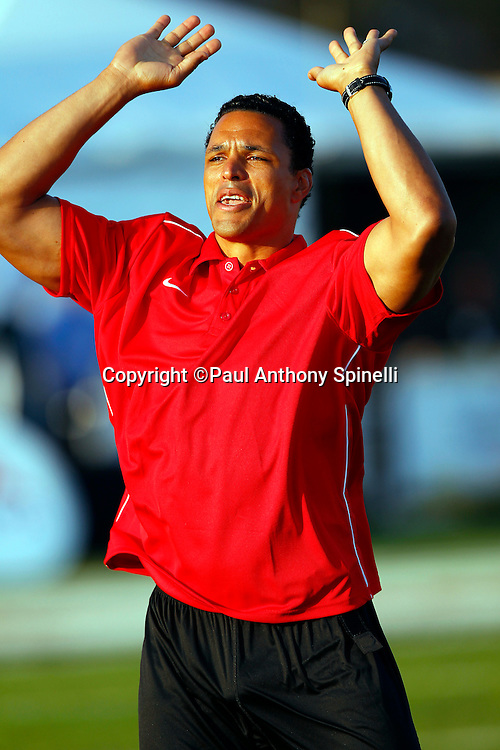 Former Kansas City Chiefs and Atlanta Falcons tight end Tony Gonzalez waves his arms in celebration as he coaches the Gamers team at the EA Sports Madden NFL 11 Launch celebrity and NFL player flag football game held at Malibu Bluffs State Park on July 22, 2010 in Malibu, California. (©Paul Anthony Spinelli)