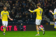 Patrick Bamford of Leeds United (9) scores a goal and celebrates with Mateusz Klich of Leeds United (43) to make the score 0-2 during the EFL Sky Bet Championship match between Preston North End and Leeds United at Deepdale, Preston, England on 9 April 2019.