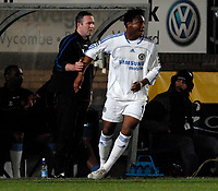 Photo: Richard Lane.<br />Wycombe Wanderers v Chelsea. Carling Cup, Semi Final 1st Leg. 10/01/2007. <br />Chelsea's John Obe Mikel runs into Wycombe manager, Paul Lambert.
