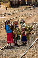 Tarahumara Indian woman and girl selling handwoven baskets at the train station, San Rafael, Copper Canyon, Mexico