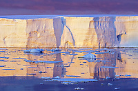 Sunset on a tabular iceberg on the Graham Coast from the Grandidier Channel in Antarctica.