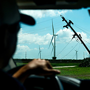 OCTOBER 13 - SANTA ISABEL, PUERTO RICO - <br /> Ruben Rivera, Facilities Manager for Pattern Energy, drives towards the wind turbines on a field near agriculture and farm animals in Santa Isabel after the path of  Hurricane Maria. Traditional wooden poles with power lines were felled by the hurricane.<br /> (Photo by Angel Valentin/Freelance)