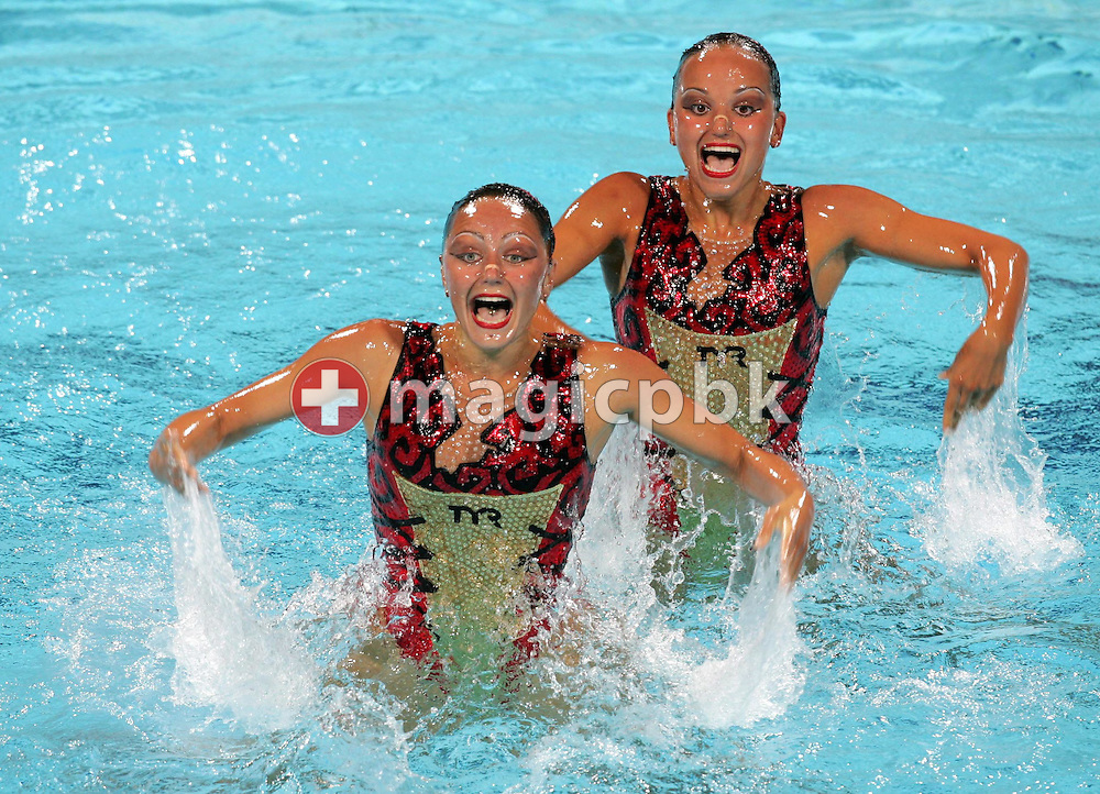 Russian Synchronised Swimming team Anastasia Davydova and Anastasia Ermakova during women's Duet Free Routine final of the Athens 2004 Olympic Games Wednesday 25 August 2004. Russia won gold.  (Photo by Patrick B. Kraemer / MAGICPBK)