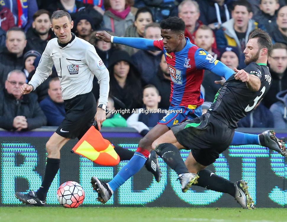 30.01.2016. Selhurst Park, London, England. Emirates FA Cup 4th Round. Crystal Palace versus Stoke. Erik Pieters takes down Wilfried Zaha