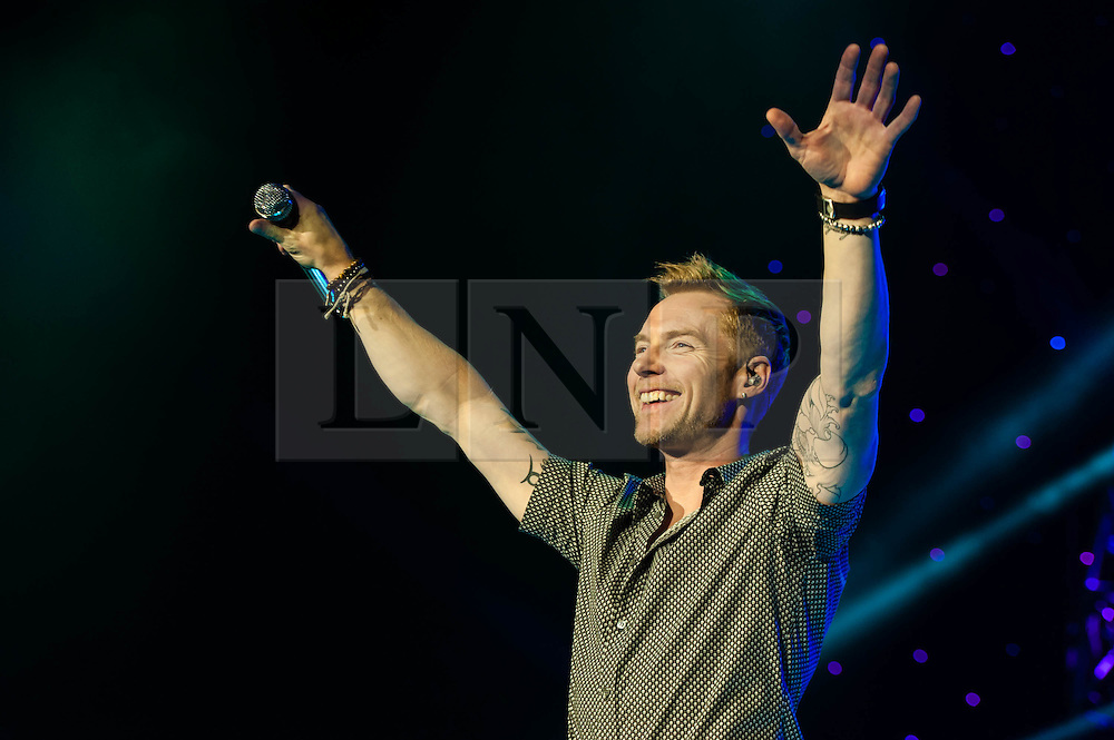 """© Licensed to London News Pictures. 26/01/2013. London, UK.   Ronan Keating performing live at The O2 Arena to promote his ninth studio album """"Fires"""". During the encore of the gig, Ronan is joined onstage by fellow Boyzone bandmate Shane Lynch, when they announce plans for Boyzone to tour the UK later in the year.  Ronan Keating is an Irish recording artist, singer-songwriter, musician, and philanthropist.  His solo career started in 1999.  Keating debuted on the professional music scene alongside Keith Duffy, Mikey Graham, Shane Lynch and Stephen Gately, in 1994 as the lead singer of Irish group Boyzone.  Photo credit : Richard Isaac/LNP"""