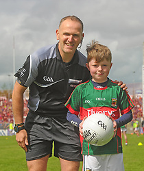 from Breaffy presenting the match ball to referee Conor Lane at McHale Park on sunday.<br />Pic Conor McKeown
