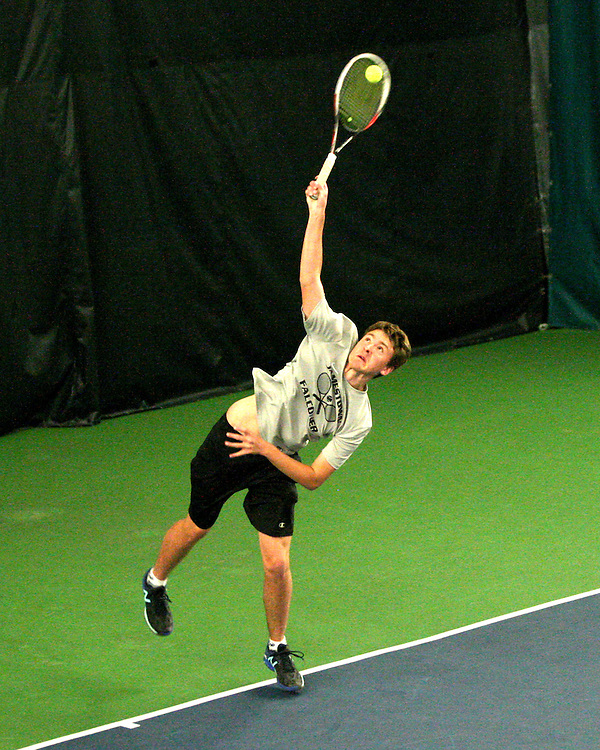 Cooper Miller Serves during tennis action at the Lakewood YMCA 4-7-16 photo by Mark L. Anderson