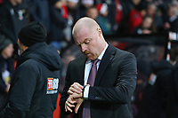 Football - 2019 / 2020 Premier League - AFC Bournemouth vs. Burnley<br /> <br /> Burnley Manager Sean Dyche checks his watch before kick off at the Vitality Stadium (Dean Court) Bournemouth <br /> <br /> COLORSPORT/SHAUN BOGGUST