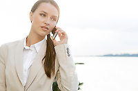 Businesswoman answering cell phone outdoors