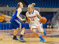 Morgantown guard Liv Seggie (11) drives past a defender against Buckhannon Upshur during a first round game at the Charleston Civic Center.