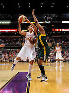 Sep 17 2011; Phoenix, AZ, USA; Phoenix Mercury guard Diana Taurasi (3) puts up a shot against the Seattle Storm forward Le'coe Willingham (34) during the first half at the US Airways Center.  Mandatory Credit: Jennifer Stewart-US PRESSWIRE.