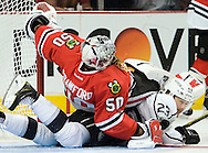 Blackhawks' goaltender Corey Crawford lands on Kings' captain Dustin Brown during the second period of Game 7 of the Western Conference Final of the 2014 NHL Stanley Cup Playoffs at the United Center in Chicago Sunday night.