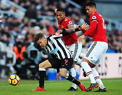 Dwight Gayle of Newcastle United battles with Antonio Valencia and Chris Smalling of Manchester United - Mandatory by-line: Matt McNulty/JMP - 11/02/2018 - FOOTBALL - St James Park - Newcastle upon Tyne, England - Newcastle United v Manchester United - Premier League
