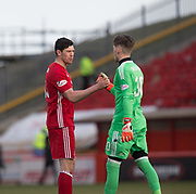 17th March 2018, Pittodrie Stadium, Aberdeen, Scotland; Scottish Premier League football, Aberdeen versus Dundee; Scott McKenna of Aberdeen celebrates with Freddie Woodman at the end