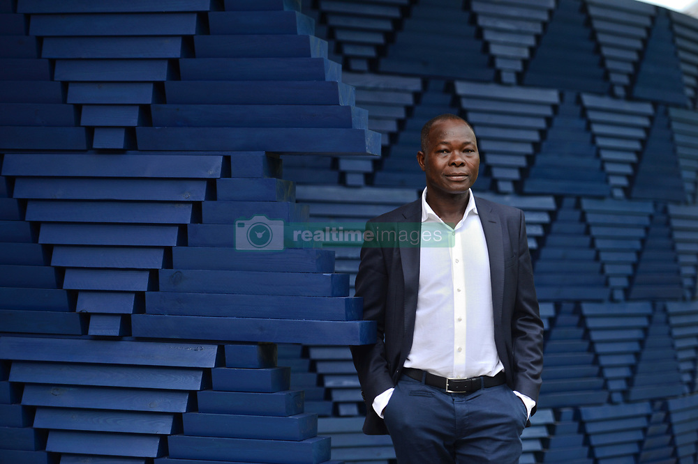 Designer Francis Kere, stands in front of his gallery design, during the press view of Serpentine Gallery Pavilion 2017, at the Serpentine Gallery in Kensington Gardens, London.