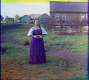 What Russian Empire Looked Like Before 1917… In Colour<br /> <br /> <br /> The Sergei Mikhailovich Prokudin-Gorskii Collection features colour photographic surveys of the vast Russian Empire made between ca. 1905 and 1915. Frequent subjects among the 2,607 distinct images include people, religious architecture, historic sites, industry and agriculture, public works construction, scenes along water and railway transportation routes, and views of villages and cities. An active photographer and scientist, Prokudin-Gorskii (1863-1944) undertook most of his ambitious colour documentary project from 1909 to 1915. <br /> <br /> Photo Shows; Girl with strawberries. (1909)<br /> ©Library of Congress/Prokudin-Gorskii/Exclusivepix Media