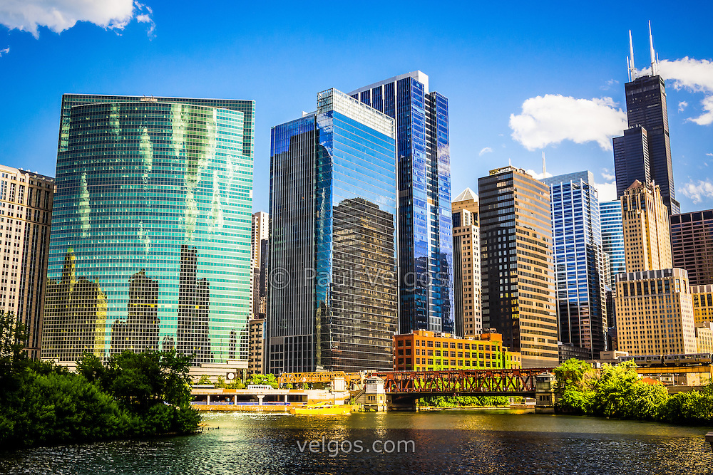 Picture of downtown Chicago city skyline with Willis Tower (Sears Tower), Nuveen building, and Lake Street Bridge. Willis Tower is one of the world's tallest skyscrapers and is a famous fixture in the Chicago skyline. Photo is high definition / high resolution.