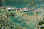 Bathing people in Krka Nationalpark, view from above. Croatia. Eastern Europe.