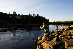 A couple fly-fishing on the Moose River below the dam on Brassua Lake in Rockwood, Maine.  Moosehead Lake region. (MR)