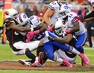 Oct. 14, 2012; Glendale, AZ, USA; Buffalo Bills running back C.J. Spiller (28) is tackled by Arizona Cardinals inside linebacker Daryl Washington (58) at University of Phoenix Stadium. The Bills defeated the Cardinals 19-16 in overtime. Mandatory Credit: Jennifer Stewart-US PRESSWIRE