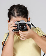 Young girl of 9 uses a manual film camera