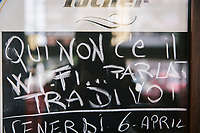 "NAPLES, ITALY - APRIL 10th 2018: A sign stating ""There is no Wi-Fi here. Talk among yourselves"" is seen here at the entrance of the Trattoria Malinconico, a popular restaurant in the Vomero district in Naples, Italy, on April 10th 2018.<br /> <br /> Trattoria Malinconico was opened in 1953 by current owner Marianna Sorrentino's parents-in-law. At first it was only a bulk wine cellar, but then he began making a few cooked dishes – small plates that were popular with locals, which eventually morphed into larger meals. Still today the trattoria is frequented the neighborhood's older residents, many of whom have been loyal regulars for years, as well as younger locals and workers, who often stop by for a glass of wine. The menu varies from day to day, and is typically based on traditional Neapolitan recipes. Though some dishes, like meatballs, sausages, and friarielli (rapini, a type of broccoli typical to Naples), are always available.<br />  <br /> <br /> Genovese sauce is a rich, onion-based pasta sauce from the region of Campania, Italy. Likely introduced to Naples from the northern Italian city of Genoa during the Renaissance, it has since become famous in Campania and forgotten elsewhere.<br /> Genovese sauce is prepared by sautéing either beef, veal or pork in a large number of onions, for at least two but as many as ten hours. Large, cylindrical pasta like rigatoni, ziti or candele are favored because they can hold the rich sauce."