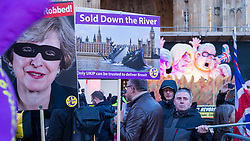 © Licensed to London News Pictures. 14/03/2019. LONDON, UK.  Pro-leave placards and a caricatures of Theresa May, Boris Johnson and Michael Gove in Westminster.   MPs have voted by 412 to 202 for Prime Minister Theresa May to ask the EU for a delay to Brexit.  Photo credit: Stephen Chung/LNP
