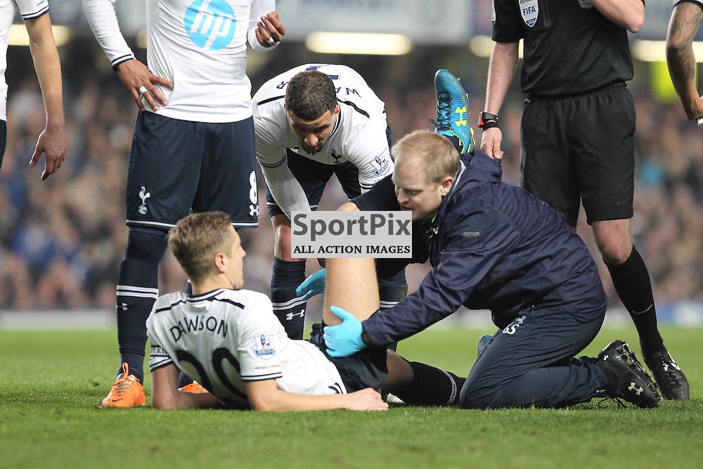 Tottenham's Michael Dawson gets treatment during the English Barclays Premiership match between Chelsea FC and Tottenham Hotspur FC at Stamford Bridge, London, 8th March 2014 © Phil Duncan | SportPix.org.uk