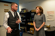 Bellmore, New York, USA. September 16, 2014. KATHLEEN RICE, Democratic congressional candidate (NY-04), speaks with PETE CARNEY, Director of Pride For Youth, a program that provides services for lesbian, gay, bisexual and transgender youth and their families. Rice, joined by local LGBT actvitists, called for congressional action both to pass legislation prohibiting employment discrimination on basis of sexual orientation and gender identity, and to fully repeal the Defense of Marriage Act. Pride For Youth is a division of the Long Island Crisis Center.