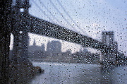Manhattan bridge through a window in the rain