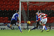 Conor Grant shoots at goal during the Sky Bet League 1 match between Doncaster Rovers and Chesterfield at the Keepmoat Stadium, Doncaster, England on 24 November 2015. Photo by Ian Lyall.
