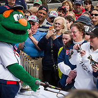 Red Sox Wally holds the 2013 World Series medal at the NH Lottery event with David Ortiz.
