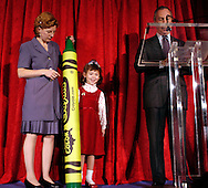 """BROOKLYN HEIGHTS, NY - OCTOBER 26: Karann Rocco (C), 6, of Rome, New York holds her New York State crayon """"Lady Liberty"""" which she named, to New York Mayor Michael Bloomberg October, 26, 2004 in Brooklyn Heights, New York. Earlier this year, Crayola constituents of all ages nominated existing crayon colors and gave them new state-themed names that draw attention to something special about every state in the union. Fifty winners were selected by Crayola from more then 25,000 names entered. """"Boston Tea Party"""" for Massachusetts and """"Alamo a la mode"""" for Texas represent the Presidential candidates home states. (Photo by William Thomas Cain)"""